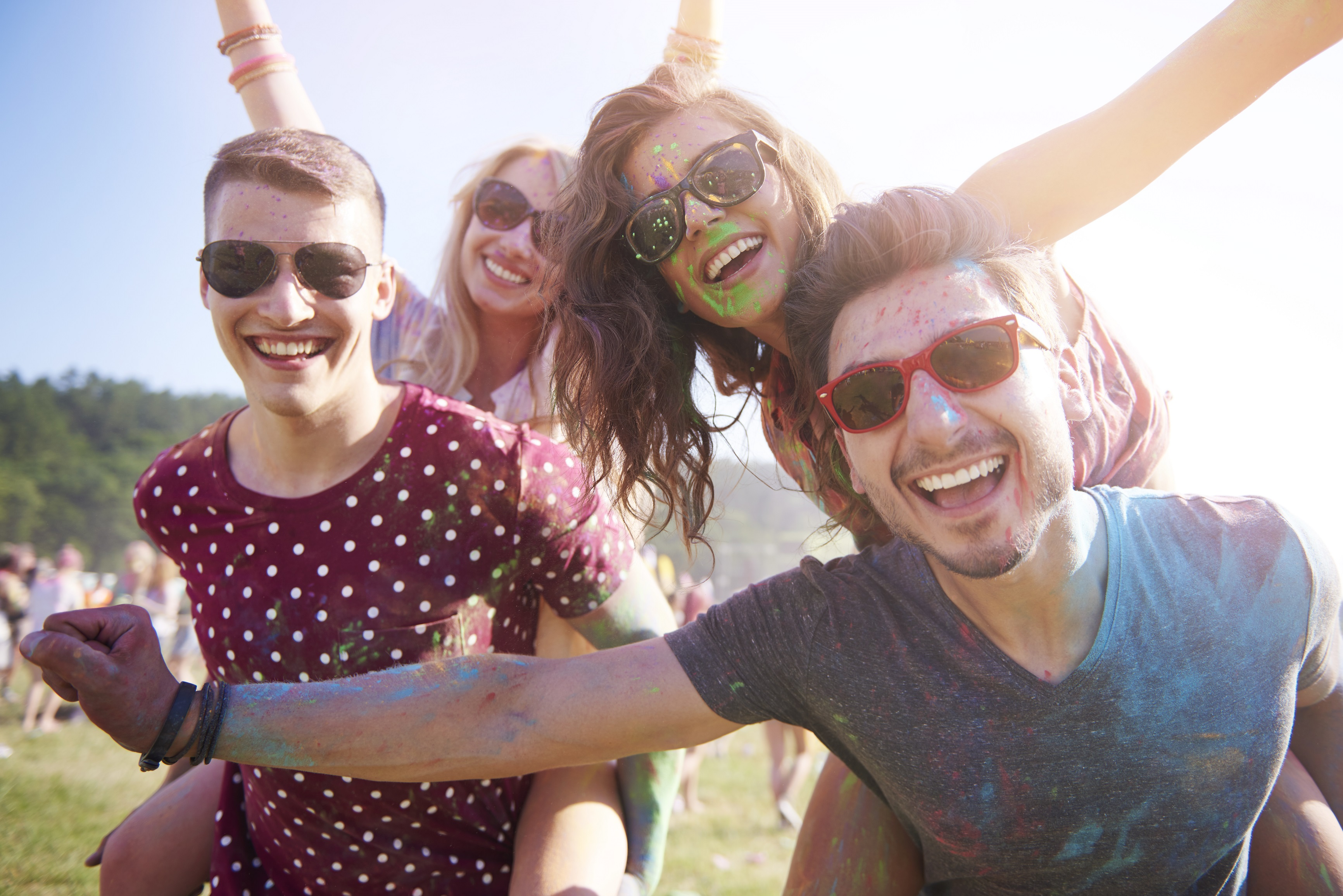 Group of friends having fun at the festival