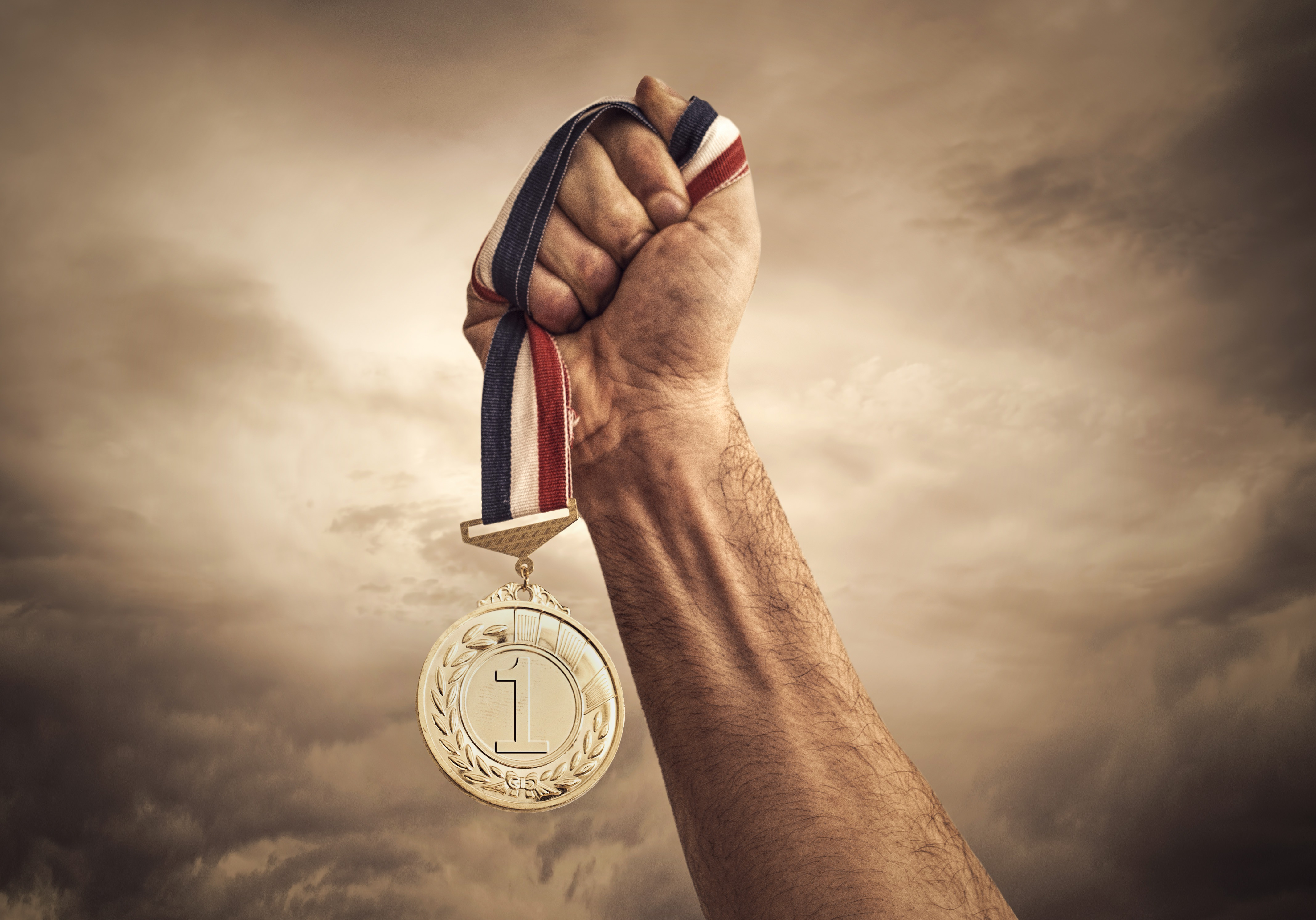 Medal Held Aloft